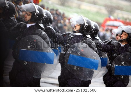 Bucharest, Romania - December 1, 2014: Soldiers march during celebrations for National Day of Romania in Bucharest, Romania.