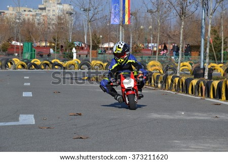 Bucharest, Romania - February 06, 2016: A kid on a mini motto In Youths Public Amusement Park (Tineretului Park). Created in 1965 is one of the largest fun parks in south Bucharest.