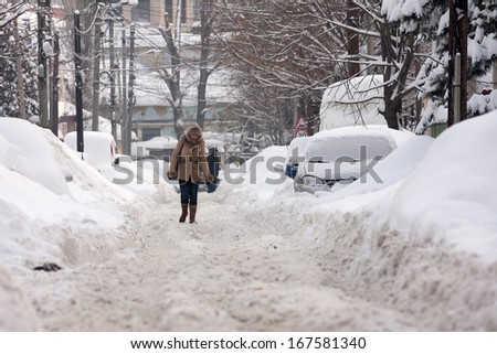 BUCHAREST ROMANIA - February 14: After the winter storm, all the streets are blocked by snow February 14, 2012 in Bucharest, Romania - stock photo