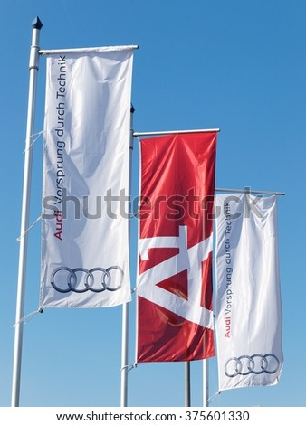 BUCHAREST, ROMANIA - FEBRUARY 07, 2016. Audi Flags in front of Audi Service. Audi AG is a German automobile manufacturer for luxury automobiles - stock photo