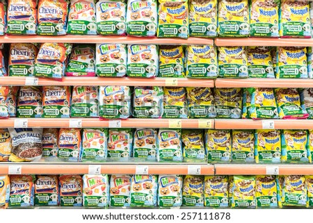 BUCHAREST, ROMANIA - FEBRUARY 25, 2015: Morning Cereals Packs On Supermarket Stand.