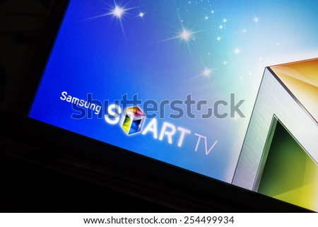 Bucharest, Romania - February 21,2015: Photo of a Samsung Smart TV screen displaying it's logo. Samsung is a South Korean multinational conglomerate company headquartered in Samsung Town, Seoul.  - stock photo