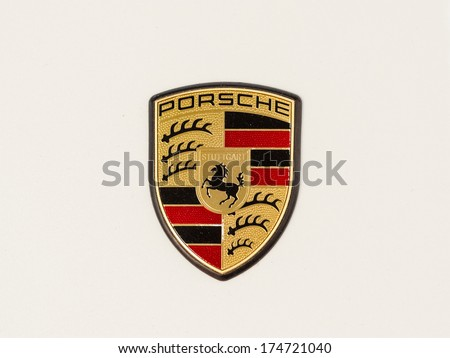 BUCHAREST, ROMANIA - FEBRUARY 03, 2014: Porsche Sign Close Up. Ferdinand Porsche founded the company in 1931 with main offices in the centre of Stuttgart. - stock photo