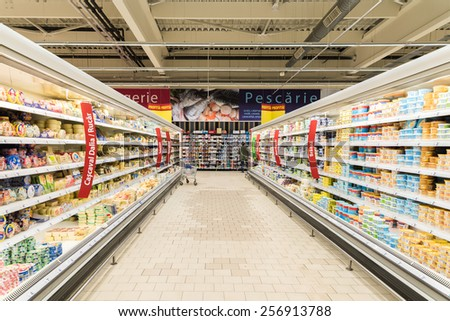 BUCHAREST, ROMANIA - FEBRUARY 25, 2015: Supermarket Food In Refrigerators On Store Aisle.