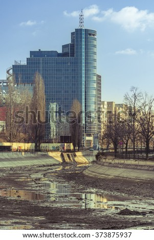 BUCHAREST, ROMANIA - FEBRUARY 06, 2016:The Chamber of Commerce and Industry of Romania situated in Bucharest and Dambovita river dried.