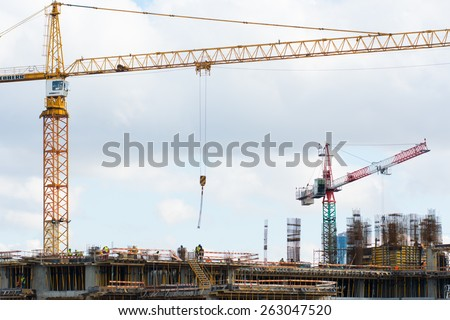 BUCHAREST, ROMANIA - February 26: Workers are constructing a new building, in Bucharest, on February 26, 2015. The Romanian real estate market is increasing. - stock photo