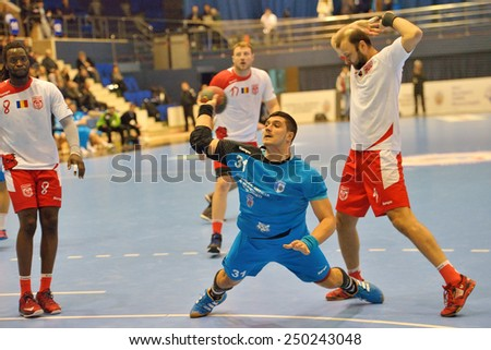 Bucharest, ROMANIA - JANUARY 28:Adrian Rotaru player of CSM Bucharest attacks during the match with Dinamo Bucharest, in Romanian Handball National Championship January 28, 2015 in Bucharest, Romania