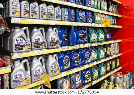 BUCHAREST, ROMANIA - JANUARY 22, 2014: Automobile Motor Oil On Supermarket Shelf On January 22, 2014 In Bucharest, Romania. It is an oil used for lubrication of various internal combustion engines. - stock photo