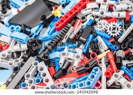 BUCHAREST, ROMANIA - JANUARY 20, 2015: Lego Technic Pieces Pile Close Up. Technic is a line of Lego interconnecting plastic rods and parts that creates more advanced models with complex movable arms. - stock photo