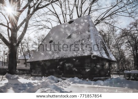 Bucharest, Romania –January20, 2017: Snowing on a wonderful winter day at the Village Museum in Bucharest, an open-air collection of old homesteads, churches, mills, etc relocated from rural Romania.