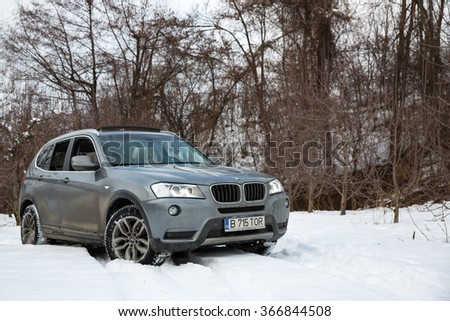 Bucharest, Romania - January 24, 2016: View of a 2013 BMW X3 F25 on a snow covered terrain. - stock photo