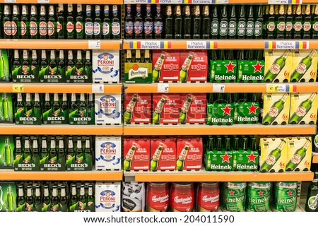 BUCHAREST, ROMANIA - JULY 09, 2014: Beer Cans On Supermarket Shelf. - stock photo
