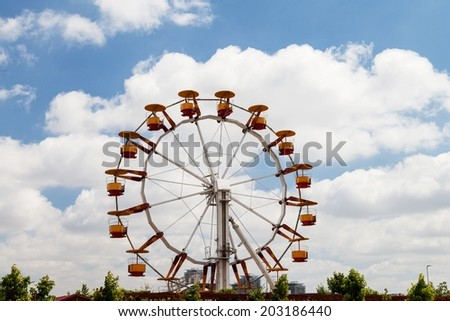 BUCHAREST, ROMANIA - JULY 01, 2014: Big Wheel located in one of the largest parks in Bucharest, Tineretului Park