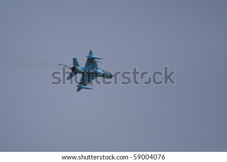 BUCHAREST, ROMANIA - JULY 17: Jet Fighters perform during the airshow on July 17, 2010 on Henri Coanda airport, Bucharest, Romania.