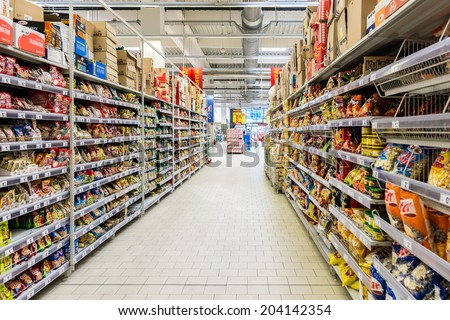 BUCHAREST, ROMANIA - JULY 09, 2014: Junk Food For Sale In Supermarket Aisle. - stock photo
