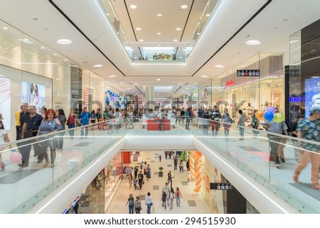 BUCHAREST, ROMANIA - JULY 06, 2015: People Crowd Rush In Shopping Luxury Mall Interior.