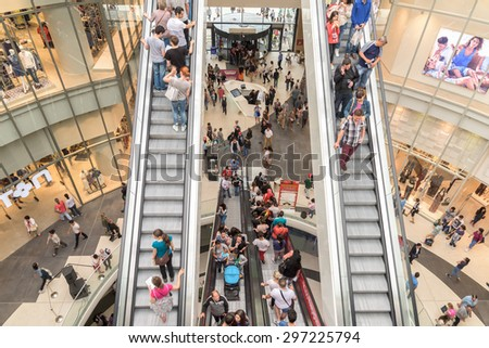 BUCHAREST, ROMANIA - JULY 16, 2015: People Crowd Rush In Shopping Luxury Mall Interior.