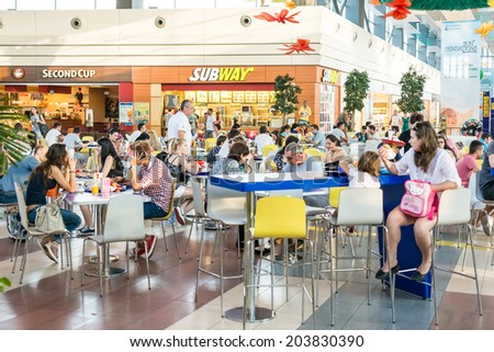 BUCHAREST, ROMANIA - JULY 07: People Eating At Subway Fast Food Restaurant In Luxurious Shopping Mall on July 07, 2014 In Bucharest, Romania. - stock photo
