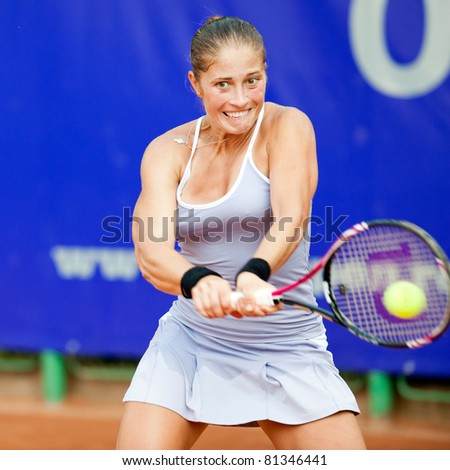 BUCHAREST, ROMANIA - JULY 19: Romanian tennis player Madalina Gojnea in action during BCR Open Ladies on July 19, 2011 in Bucharest, Romania