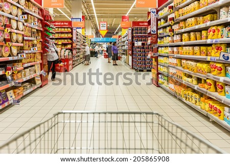 BUCHAREST, ROMANIA - JULY 18, 2014: Shopping Cart View Of People Shopping In Supermarket Store. - stock photo