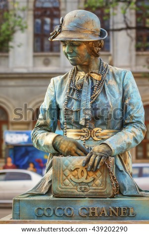Bucharest, Romania - June 10, 2016: Coco Chanel living statue at B-FIT in the Street. B-FIT is a cultural event that involves international artists and acrobats, who act in theater plays on street. - stock photo