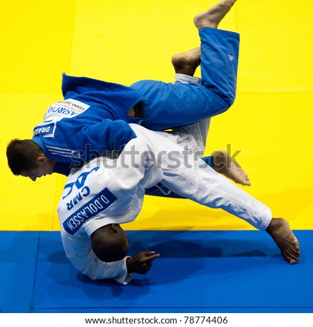 BUCHAREST, ROMANIA - JUNE 4: Contestants participate in the Judo World Cup Men 2011 on June 4, 2011, Bucharest, Romania - stock photo