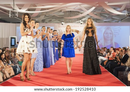 BUCHAREST, ROMANIA - JUNE 12: Fashion models wear clothes from Nausica Mircea collection, in Bucharest Fashion Week at World Trade Center on June 12, 2013 in Bucharest, Romania - stock photo