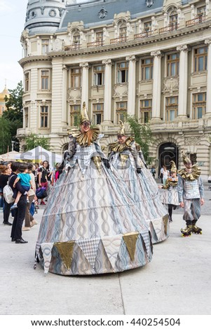 "BUCHAREST, ROMANIA - JUNE 09, 2016: Harlequins company (Slovakia) present itinerant show inside of International Festival of Street Theater, ""B-FIT in the street 2016"""