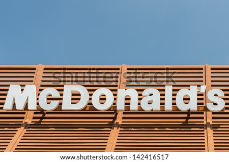 BUCHAREST, ROMANIA - JUNE 16: McDonald's Restaurant Sign on June 16, 2013 in Bucharest, Romania. McDonald's Corporation is the world's largest chain of fast food restaurants.