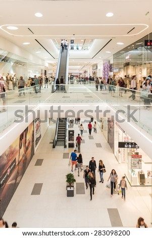 BUCHAREST, ROMANIA - JUNE 01, 2015: People Crowd Shopping In Luxury Mall Interior.