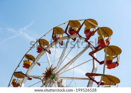 BUCHAREST, ROMANIA - JUNE 08, 2014: People Riding Giant Ferris Wheel In Youths Public Amusement Park (Tineretului Park) On Summer Day.