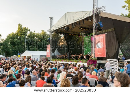 BUCHAREST, ROMANIA - JUNE 28, 2014: People Watching Free Classical Music Concert At Bucharest Music Film Festival In George Enescu Square Near The Romanian Athenaeum. - stock photo