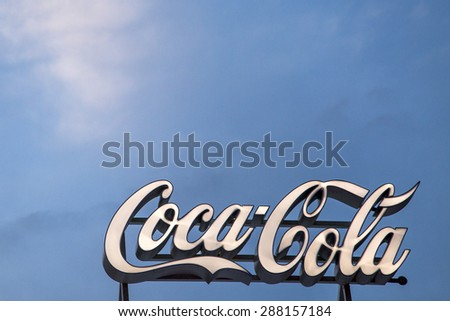 BUCHAREST, ROMANIA - June 18,2015: To celebrate the 100th birthday of the Coca-Cola contour bottle, a pop-up store will be open at University Square in Bucharest. Logo of Coca-Cola Company.