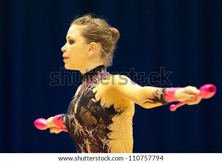 BUCHAREST, ROMANIA - JUNE 17: Unknown gymnast performs during the Irina Deleanu Orange Trophy on June 17, 2012, Bucharest, Romania - stock photo