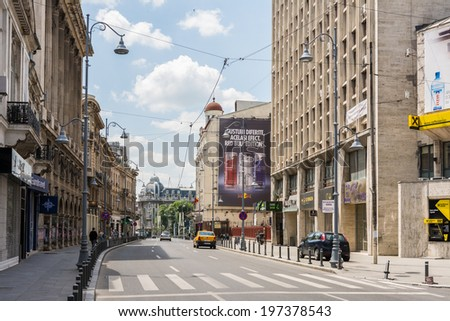 BUCHAREST, ROMANIA - JUNE 08, 2014: Victory Avenue. Calea Victoriei (Victory Avenue) is a major avenue in central Bucharest and is the boulevard with the most expensive shops in Bucharest.