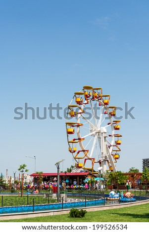 BUCHAREST, ROMANIA - JUNE 08, 2014: Youths Public Amusement Park View (Tineretului Park) On Summer Day. Created in 1965 is one of the largest fun parks in south Bucharest. - stock photo