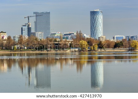 Bucharest, Romania - March 07, 2016: Bucharest Sky Tower Business Center. Bucharest urban landscape with building reflected in water.