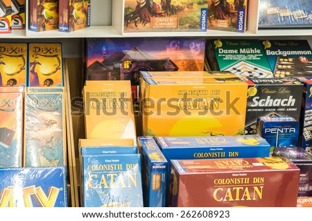 BUCHAREST, ROMANIA - MARCH 22, 2015: Children Board Games For Sale On Library Shelf.