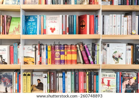 BUCHAREST, ROMANIA - MARCH 15, 2015: Famous Books For Sale On Library Shelf.