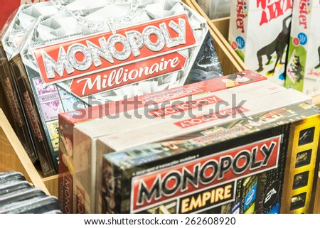 BUCHAREST, ROMANIA - MARCH 22, 2015: Monopoly Game For Sale On Library Shelf. Monopoly is a board game that originated in the United States in 1903 as a way to demonstrate the evils of land ownership - stock photo