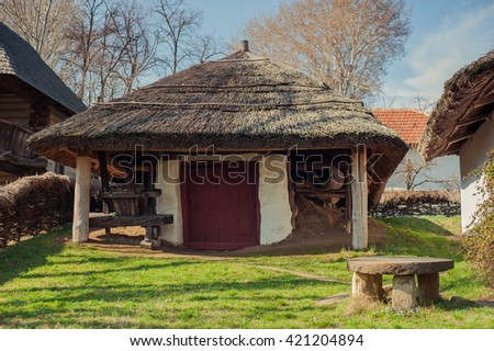 Bucharest, Romania - March, 6th 2016: A village cottage in the Village museum park