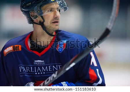 BUCHAREST, ROMANIA - MARCH 2: Unidentified hockey player compete during the Steaua Rangers vs Corona Brasovl game at Flamaropol Stadium, score 3-2, on March 2, 2012 in Bucharest, Romania. - stock photo