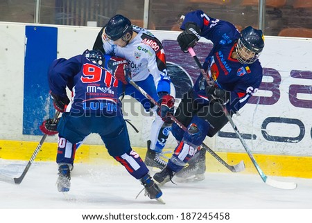 BUCHAREST, ROMANIA - MARCH 2: Unidentified hockey players compete during the Steaua Rangers vs Corona Brasov game at Flamaropol Stadium, score 3-2, on March 2 , 2012 in Bucharest, Romania - stock photo