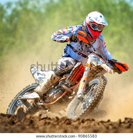 BUCHAREST, ROMANIA - MAY 14: An unidentified rider participates in the Third National Endurocross Championship on May 14, 2011 at Ciolpani in Bucharest, Romania