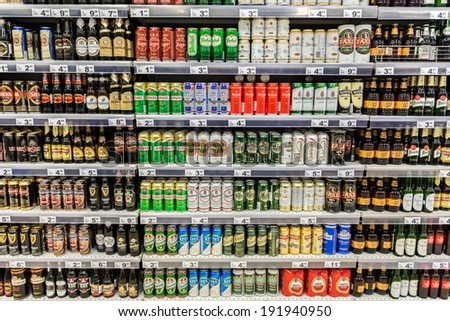 BUCHAREST, ROMANIA - MAY 08: Beer Cans On Supermarket Shelf on May 08, 2014 in Bucharest, Romania. - stock photo