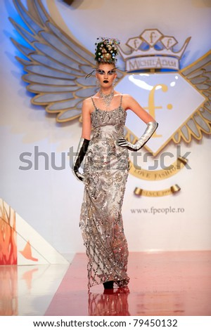BUCHAREST, ROMANIA - MAY 7: Fashion model wears clothes made by Catalin Botezatu, Black Gold collection, in Bucharest Fashion Week at World Trade Center on May 7, 2011, Bucharest, Romania - stock photo
