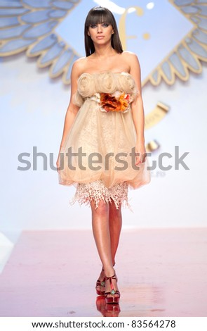 BUCHAREST, ROMANIA - MAY 7: Fashion model wears clothes made by Giada Curti, in Bucharest Fashion Week at World Trade Center on May 7, 2011, Bucharest, Romania - stock photo