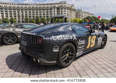BUCHAREST, ROMANIA - MAY 7: Ferrari F12tdf on display in Constitution Square on May 7, 2016 in Bucharest. The car is part of the Gumball 3000 Dublin to Bucharest Charity Grid Rally. - stock photo
