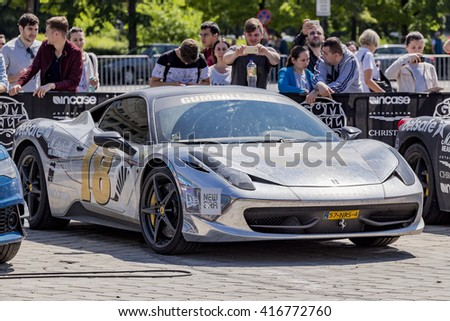 BUCHAREST, ROMANIA - MAY 7: Mirror paint Ferrari 458 on display on May 7, 2016 in Bucharest. The car is part of the Gumball 3000 Dublin to Bucharest Charity Grid Rally. - stock photo