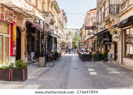 BUCHAREST, ROMANIA - MAY 05, 2015: People Enjoy Spring Time Downtown Lipscani Street. Lipscani is one of the most busiest and oldest street of Bucharest.